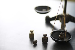 Tiny weights vintage balance scales. Detail of Ancient old scale, Vintage old brass weight scale.