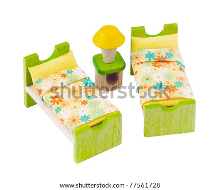 Tiny wooden toy furniture isolated on white