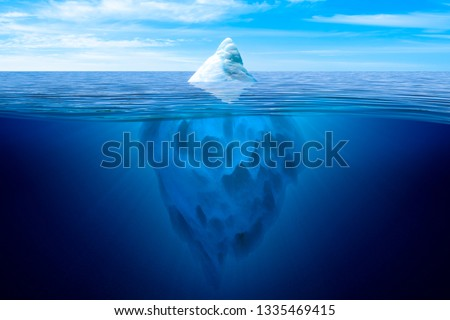 Tip of the iceberg. Underwater iceberg floating in ocean. #1335469415