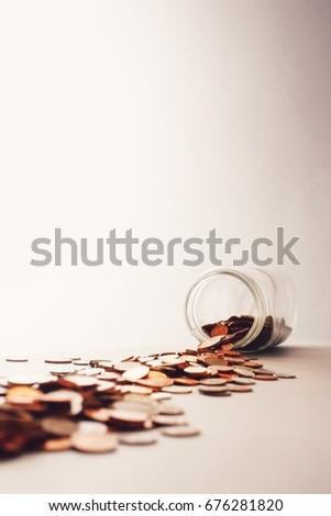 Tipped Coin Jar