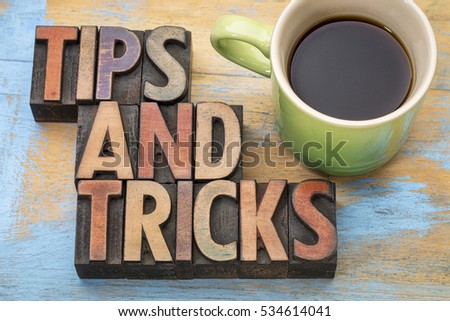 tips and tricks word abstract in letterpress wood type with a cup of coffee