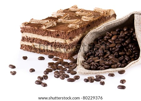 Tiramisu cake with bag of coffee beans isolated over white