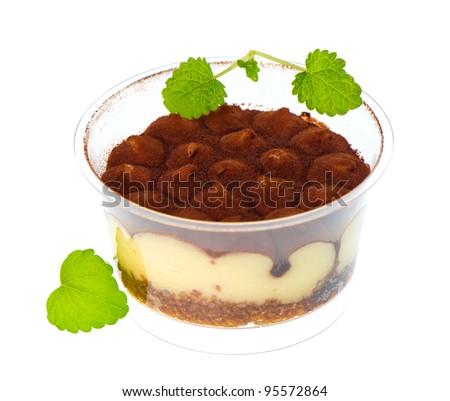 tiramisu cake with fresh mint leaves decoration on white background. sweet dessert