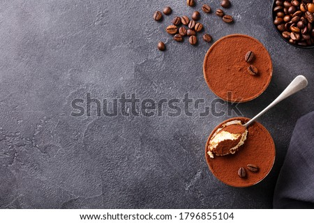 Tiramisu dessert in glasses. Dark grey background. Copy space. Top view. Photo stock ©