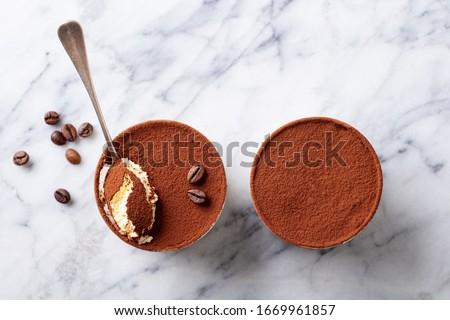 Tiramisu dessert in glasses. Marble background. Copy space. Top view. Photo stock ©