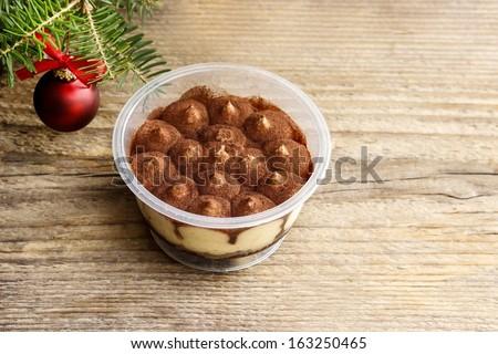 Tiramisu dessert on wooden table. Italian confectionery