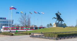 Tiraspol. Suvorov's monument- founder of the city. Official, state flags and flags of settlements of Transnistria. Equestrian statue to the russian commander Alexander Suvorov near the Dniester River.