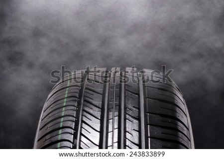 Tire Car with smoke on black background