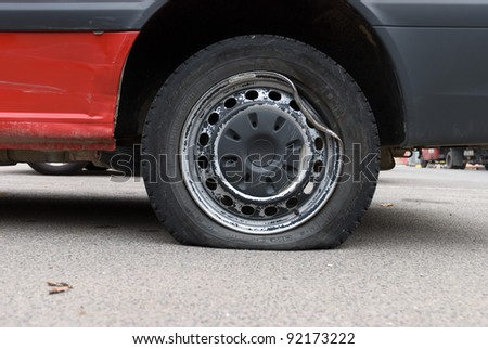 Tire damage or puncture - stock photo