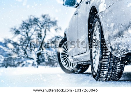 Tire in winter on snow road. Tires on snow. Car detail.