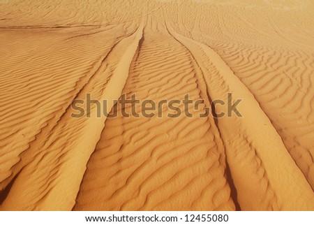 Tire tracks on sand dunes in Wadi Rum desert, Jordan