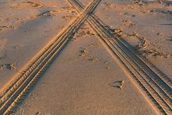 Tire tread marks on sand, selective focus