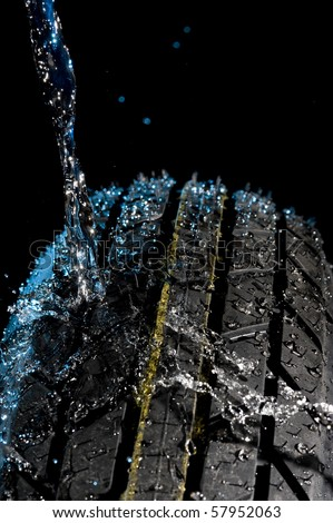 Tire with water drops on it black background