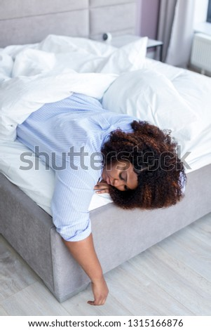tired african american woman sleeping in bed at home. close up photo. rest time. free time, spare time