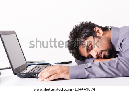 tired and fatigued businessman sleeping on the desk