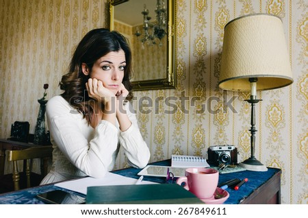 Tired and overwhelmed young woman studying or working at home. Bored female entrepreneur or student. Professional frustration and stress.