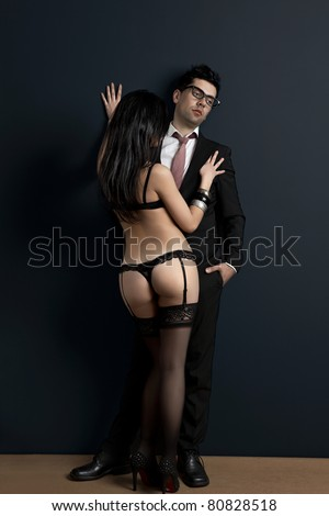 Tired and upset businessman with a sexy young woman in lingerie. Concept about work and pleasure