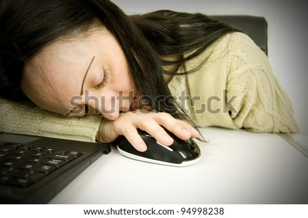tired at work, woman asleep on computer keyboard and mouse in office