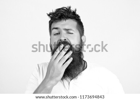 Tired bored businessman yawning, boring work, dead end job, overwork extra after hours, lack of sleep, insomnia consequences, need rest. Young guy with beard sleeps on pillow and yawn, black and white Stock fotó ©