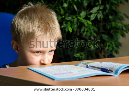 Tired boring boy don\'t want to do his difficult school homework