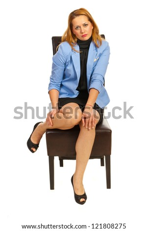 Tired business woman with hurting legs sitting on chair isolated on white background