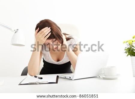 Tired business woman working on her workspace - stock photo
