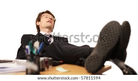 tired businessman asleep at work