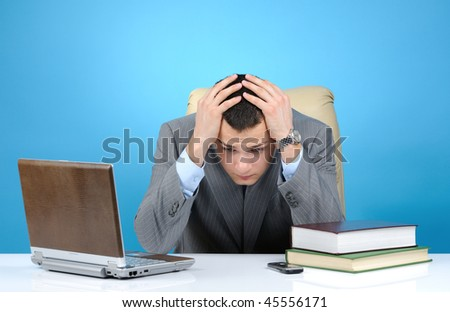 Tired businessman on blue background