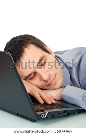 Tired businessman sleeping in the office, he putting his head onto keyboard of the laptop