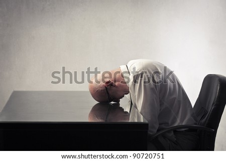 Tired businessman sleeping on a table