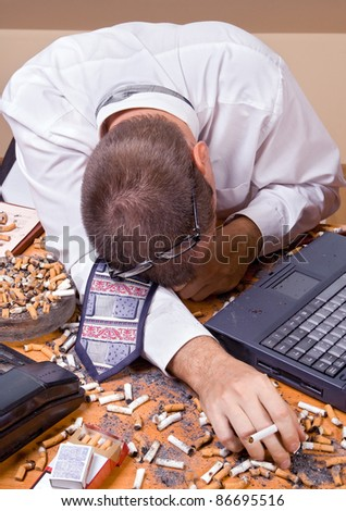Tired businessman with cigarette