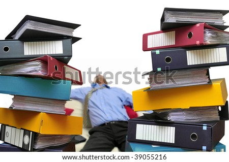 Tired businessman with stacks of files isolated in white