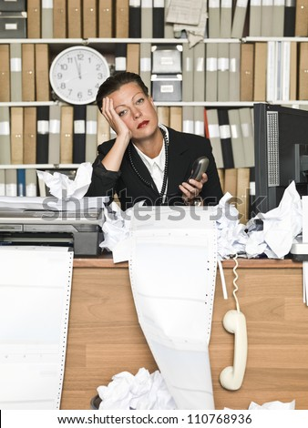 Tired Businesswoman at the messy office