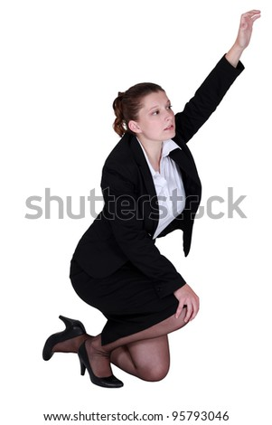 Tired businesswoman desperate to be heard - stock photo