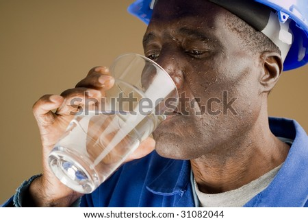 Tired Construction Worker Drinking Water