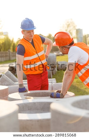 Tired construction workers having small talk at work