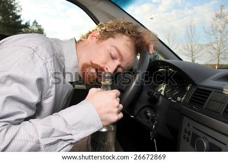 tired driver sleeps in a car