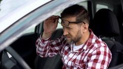Tired driver taking eyeglasses off, eyesight disease, health weakness, health