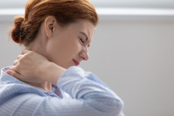 Tired fatigued business woman office worker feeling pain chronic discomfort injury hurt rubbing stiff tensed sore neck muscles suffer from fibromyalgia ache after sedentary work in incorrect posture