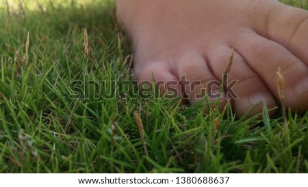 Tired feet resting on soft comfy grass.  Grass not trim or cut but naturally grow. #1380688637