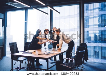 Tired female director in office feeling headache during deadline with employees cooperating on accounting near desktop, group of mature men and women checking information from financial reports