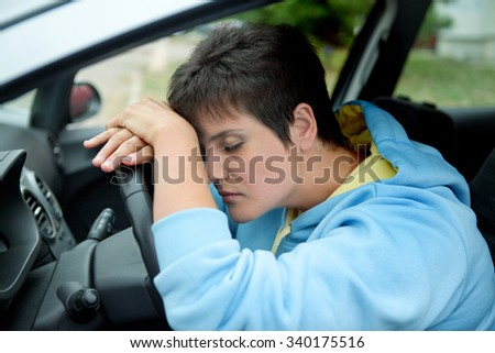 Tired Girl Driving a Car