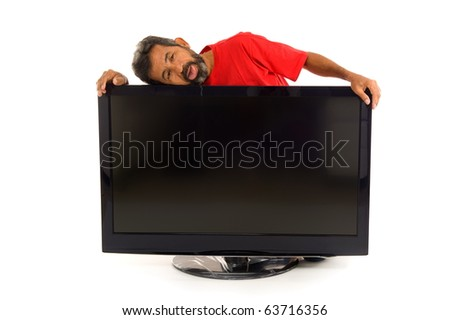 Tired man hugging the tv on white background .