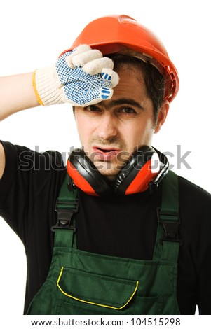 Tired man in a construction helmet on a white background.