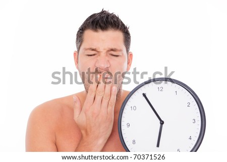 Tired man portrait holding clock ywaing