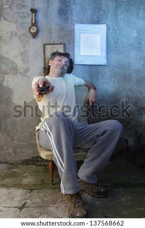 tired man with remote control
