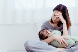 Tired Mother Suffering from experiencing postnatal depression.Health care single mom motherhood stressful.