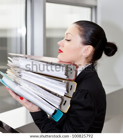 Tired secretary with a lot of documents