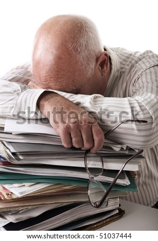 Tired senior man with papers