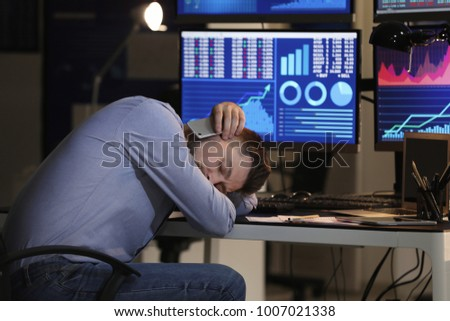 Tired stock exchange trader sleeping in office